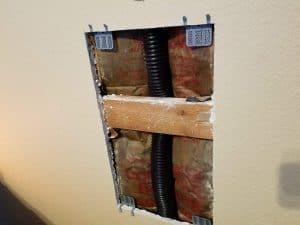 Repairing a large drywall hole - adding drywall repair clips