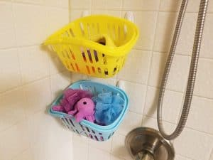 Bath toy storage with Dollar Store baskets and Command Hooks